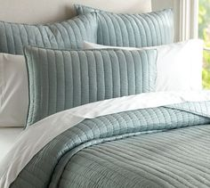 Silk Channel Two-Toned Quilt & Sham | Pottery Barn in gray mist or porcelain blue.