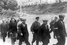 German soldiers leading Jews to forced labor