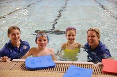 Two National Deaf Children's Society swim instructors provide sign language…