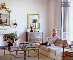 """Princess Lee Radziwill.  Elle Decor recently published her two apartments:  in Paris, she lives in a small flat bathed in sunlight.   The apartment is filled with white and touches of pink.   The sofa is a early Christian Liaigre and the two commodes are steel.   Simple seagrass covers the wood floors which are not stained and were left unfinished, so that they feel """"sandy."""""""