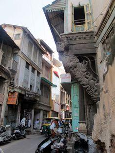 India, Ahmedabad. What I love about this photo showing you the buildings are very distressed but then you see such a beautiful carving amongst all of this