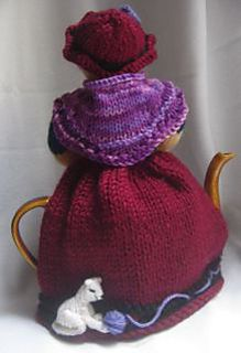The back is so sweet, with a kitty at her feet. The face? Not so much, it needs a lighter touch!