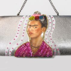 upcycled silver clutch purse with sequined image of Frida on both sides..... OH KARLY IT'S ME!!!!! LOL