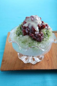 "【Kakigoori (Shaved Ice)】 Cold dessert with sweet syrup. This is one of summer specialities in Japan. We also call it ""Natsu Goori"" which means summer ice."
