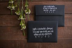 white and black wedding envelopes in calligraphy