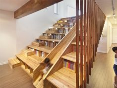 designed by the ever-so-brilliant architect Moon Hoon, the Panorama House features the ultimate space-saving library, with book shelves embedded in the stairs. Not only that, but the shelves double as seating for a casual home theatre that's built into the opposing wall. Oh, and there's A GIANT WOODEN SLIDE that runs the length of the entire construction