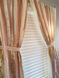 Pink and gold garland curtain is made with a blends of ivory, white, pink and sparkley gold sequin and lace.