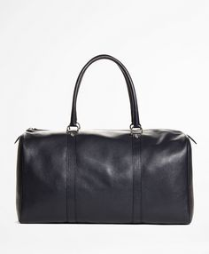 """Elevated duffle bag in soft pebble leather with twill lining. 10½"""" x 20"""" x 9¼"""" with a 20"""" handle drop. Made in Italy."""