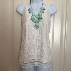 ✨B1G1 FREEHPExpress Ivory Crochet Overlay Tank Very pretty top with crochet like overlay with a slight sparkle in the thread. Looks great with a statement necklace and bright pants. It is in great condition. Front: 92% polyester 8% metallic Lining: 60% cotton 40% modal ✨Buy one item at list price and pick another equal or lower priced item for free-I can bundle them together for you✨If only interested in this item then feel free to make an offer✨ Selected as a Spring Trends Host Pick 4.21.16…