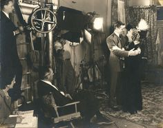 Behind the scenes portrait of Clark Gable, Jeanette MacDonald and director Robert Hopkins from San Francisco.