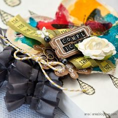 canvas, tape measure, ticket, twine... layers and layers of pretty things
