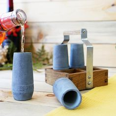 @sparqhome vodka shooters s/4 - Serve your vodka in a way that will send a chill through your guests. These hand-crafted vodka shooters make a statement ? You know good vodka. Simply pull the shooters from the freezer, pour the vodka, and enjoy a chilled shot. These two-ounce shooters come with a rustic wooden serving tray, making it easy & stylish to transport from kitchen to table.
