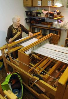 CHARLESTON, W.Va. -- Twice a week, the Lucy Quarrier Weavers gather in two second floor rooms in an office building on Lee Street. Wooden floor looms line the walls. The women chat and laugh as they settle into the benches behind their looms on Mondays and Fridays.