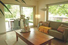 Wohnzimmer mit Ausblick in den Garten in Schwalmtal Lüttelforst