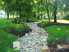 Dry Creek Bed For Drainage | ... is too shady to grow grass or too steep to mow a dry stream bed dry