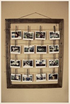 A rustic photo display by hanging wire horizontally in an old frame