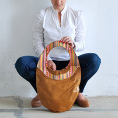 Large camel tote handbag, made of best quality genuine leather. Camel brown color. It can be hold on the shoulder and use as everyday handbag. Large to fit so many things in.... whatever you need to curry every day... your purse, agenda, glasses, cosmetics, notebook, ipad etc. The inside