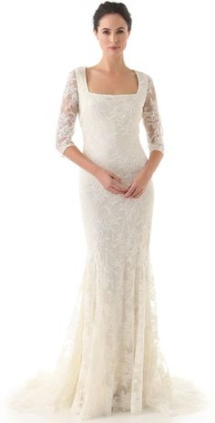 save 35% on your Badgley Mischka vintage wedding lace gown. the loveliest sleeves we have ever seen.