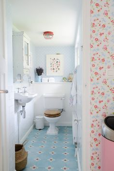Great example of using a wall hung sink in a tiny bath