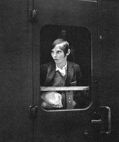 By Eva Rubinstein. London 1969. http://www.artnet.com/artists/eva-rubinstein/young-woman-on-a-train-england-N1Pv8RenmoAB38nwGv_kRg2 • Not by Henri C-Bresson!