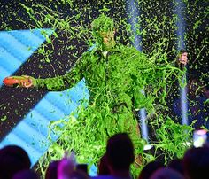 The Nickelodeon Kids' Choice Awards is an annual awards show that airs on the Nickelodeon cable channel. Best known to overwhelmingly cover people with the network's trademark green slime. Celebrity Photos, Celebrity News, Cable Channels, Slime Videos, 90s Childhood, Blake Shelton, How To Memorize Things, Celebrities, Choice Awards