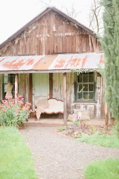 Farm Store made home! Tickles me fancy! Paint that tin a wild color over the porch! And paint it all up cutesy. :)