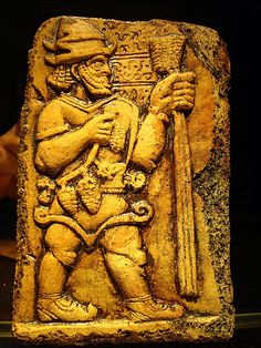 The Hittite sky-god, named Tarhunzas, here depicted with a long mace or sceptre and bunches of grapes.