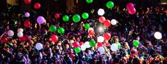 photo young people partying with balloons in the air
