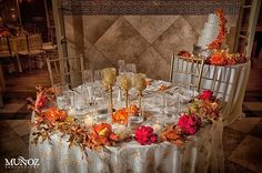 "Lots of brides opt for the ""sweatheart table"" for their reception.  This one in peach and gold is beautiful! weddingsbytheaddison.com"