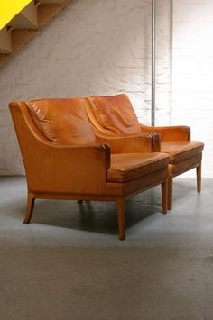 Wonder what they cost.  They were probably worth it! The Modern Warehouse - Furniture - Elegant Danish Armchairs