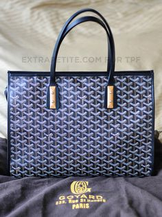 goyard marquises tote. this will hold shape better than st louis anddd has a zipper!