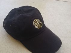 Simple rhinestone tennis ball on a dark black low profile hat.  This is from Rhinestone Studio Inc on Etsy. I wear this hat all the time.
