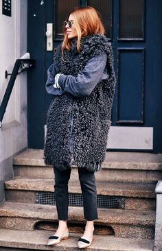 Maja Wyh stays warms in a shaggy oversized vest layered over a loose sweater and skinny jeans