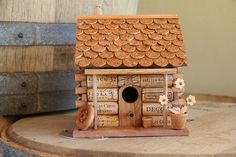 Log Cabin birdhouse, wood and wine corks....but thinking a copper roof with pennies.