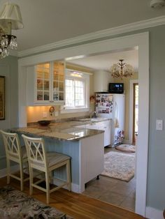 Stock island makeover kitchen in neutrals with white for Turning a galley kitchen into an open kitchen