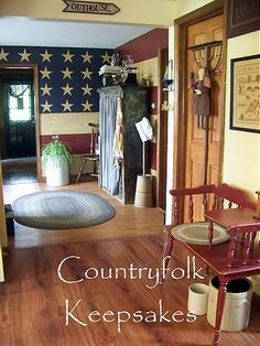 "Country Prims...love the ""Flag"" treatment on the wall & the rake hanging on the door!"
