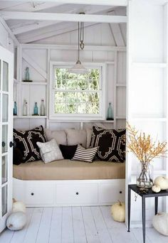 Washed out beach tones and comfy throw pillows will instantly create the perfect reading nook.