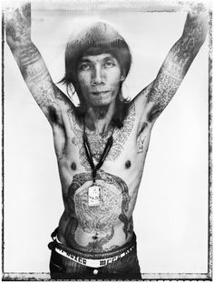 'Sacred Ink' is a photographic and multimedia installation exhibition by Cedric Arnold.