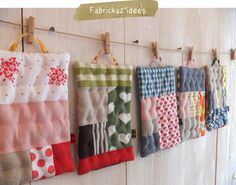 patchwork pot-holders..... hanging up like this it makes me think of a dollies washday!
