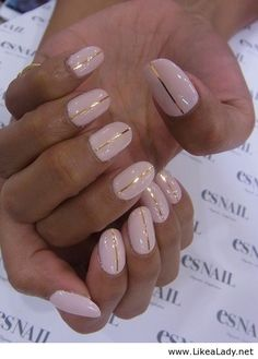 Simple light pink nails with a gold line