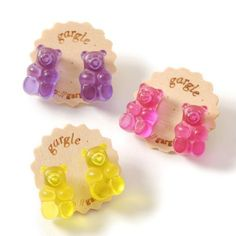 The only thing that could make these Gummy Bear Earrings by gargle more kawaii is if they were real candy! Three colors are available: Raspberry (Magenta), Lemon (Yellow), and Grape (Purple). Each features a gummy bear charm that is about cm in size o Kawaii Accessories, Kawaii Jewelry, Cute Jewelry, Jewelry Accessories, Candy Jewelry, Bts Earrings, Bridal Earrings, Emoji Earrings, Gold Earrings
