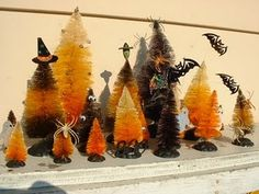 Such a cute display!  'How to' tutorial on the trees.... will need to like crafting!!  I'd like someone else to do them and then 'gift' them to me!  (Hint! Hint!)    :)