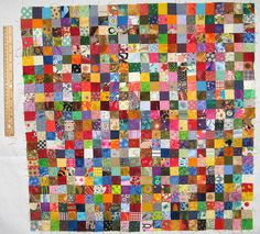 Amazing bitty bitty quilt by Katxn of Flickr/Craftster