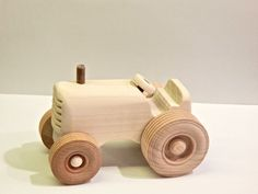 This toy is made out of poplar wood with maple wheels. It is finished with Beeswax and mineral oil ( non toxic finish ) Dimensions: 5 long 3 wide wheel base 1.5 wide body 3.25 tall.  Please note that the toy contains small pieces.   Thanks for looking at my shop. Please stop back often to see whats new
