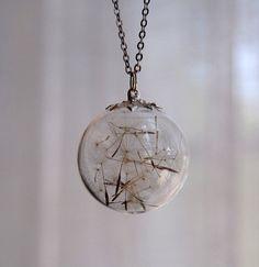pendant filled with dandelion seeds - de la Lune on etsy $26.00