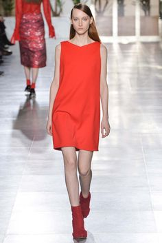 In this design by Osman for Fall 2015 RTW, elements that include the silhouette, the color and the hemline of the dress can all be seen in the 1960s retro dresses. The hemline above the knee but not the the length of a mini dress is a characteristic of a retro dress. Furthermore, the red-orange color as well as the straight and simple silhouette all scream 1960s. 1/28/15