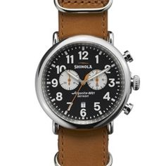The Runwell Chrono 47mm brown NATO strap chronograph watch with black dial features the Argonite 5021 quartz movement that drives the hours, minutes, small seconds, date indicator and stopwatch function with one subdial.