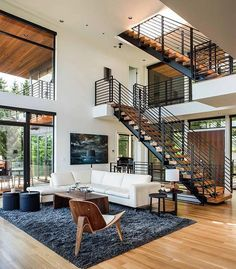 What a pretty house! I like the way the wood complements the color ...