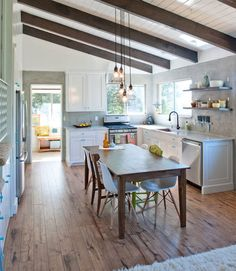 Slanted Ceiling Lighting: View In Gallery Skylights Usher Ample Ventilation While Highlighting The Slanted  Ceiling .,Lighting