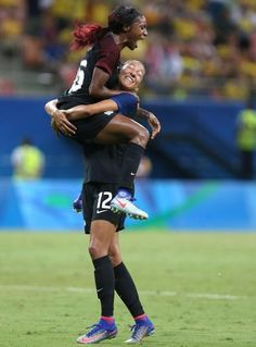 United States' Crystal Dunn, top, celebrates scoring her side's first goal with teammate Christen Press during a group G match of the women's Olympic football tournament between Colombia and United States at the Arena Amazonia stadium in Manaus, Brazil, Tuesday, Aug. 9, 2016. The game ended in a 2-2 draw. (AP Photo/Michael Dantas)
